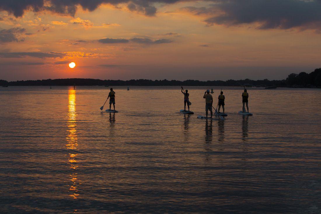 People paddleboarding with Aloha Paddle sports
