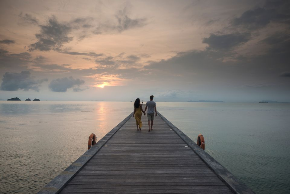 Couple on pier, Taling Ngam Beach, Ko Samui, Thailand