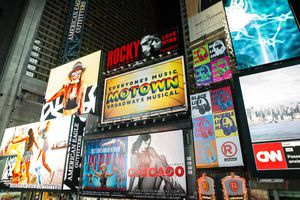 Broadway theater billboards in Times Square at night, New York