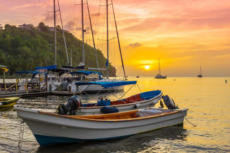 Boats docked in Marigot Bay at sunset