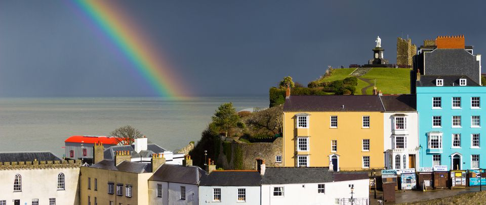 Rainbow over a colourful Welsh town