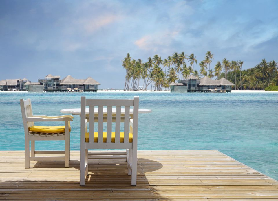 Pier with table and chairs in the Maldives
