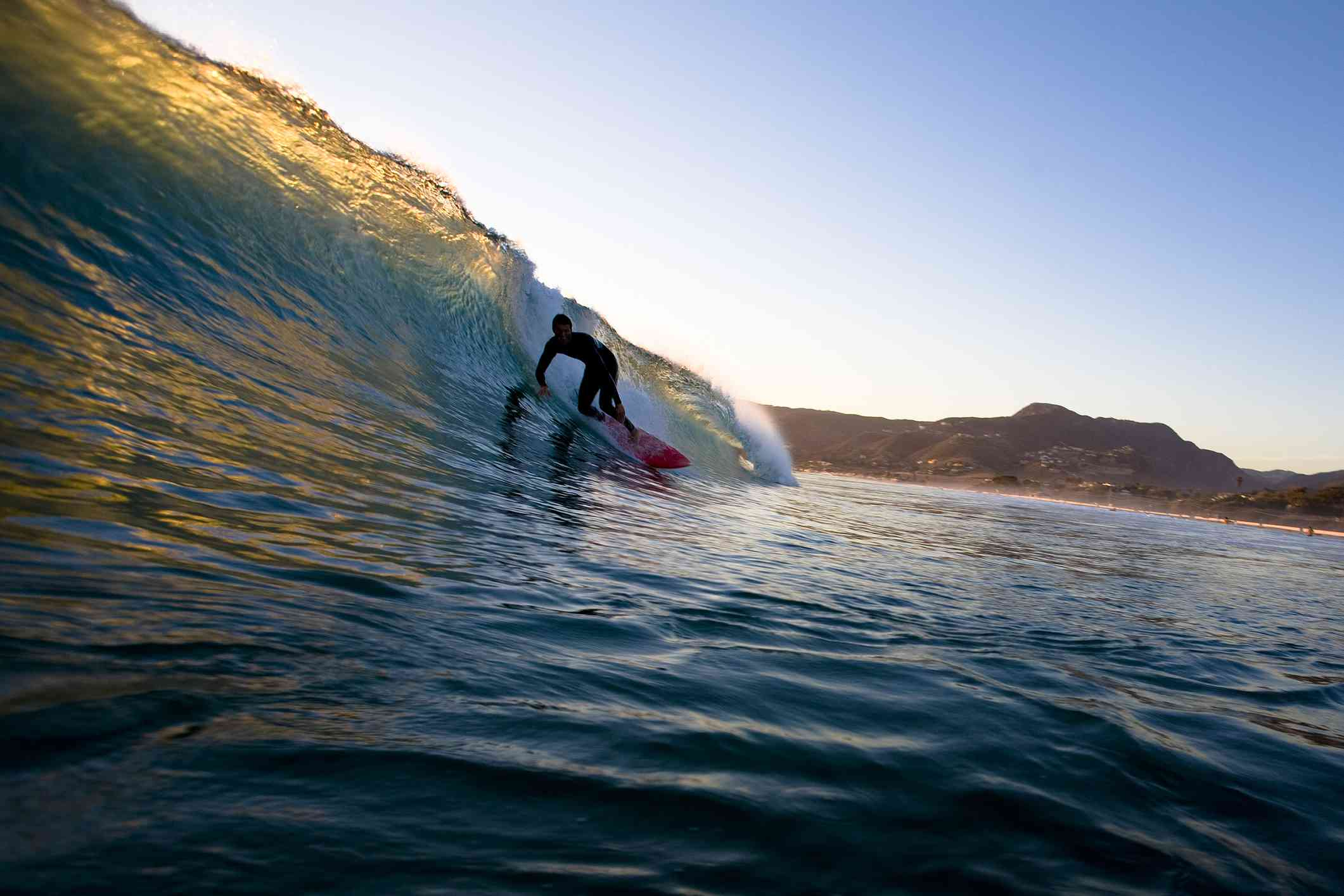Surfer at Zuma Beach, Malibu CA