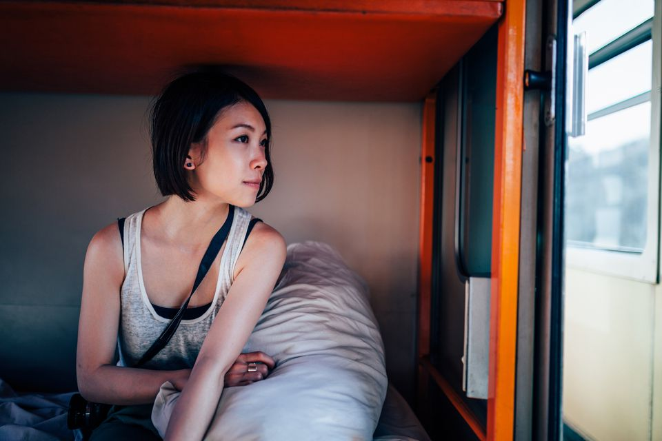 girl in sleeper car of train