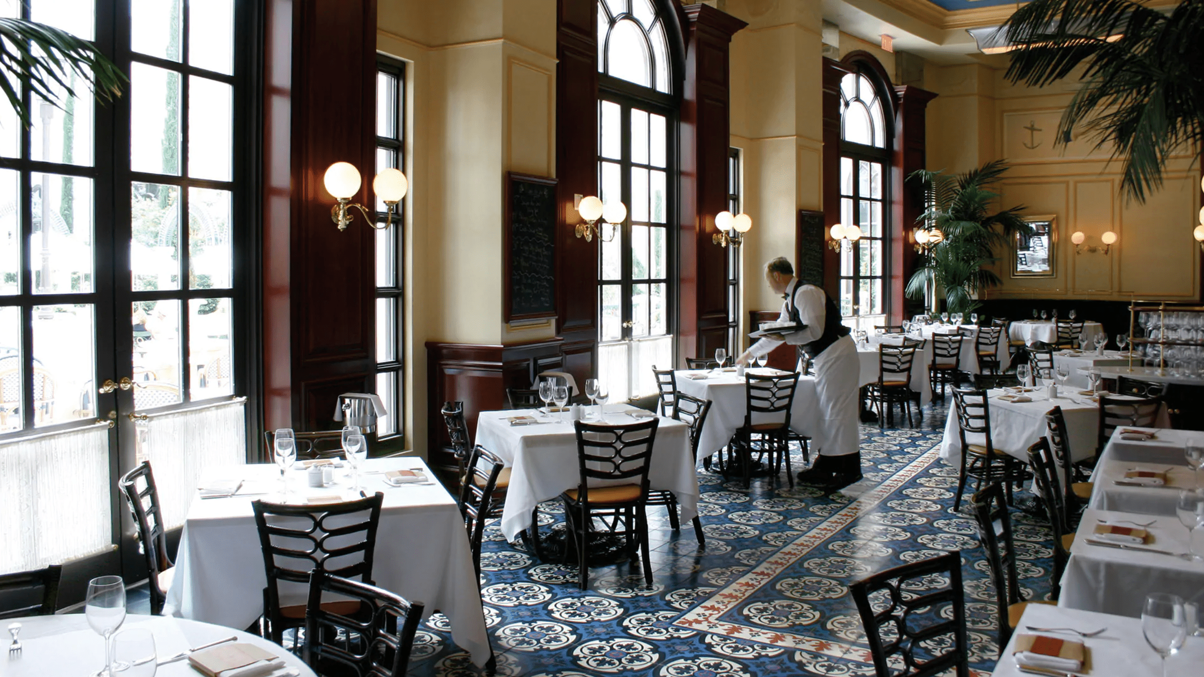 waiter setting a table in the Bouchon restaurant in the Venetian Las Vegas resort