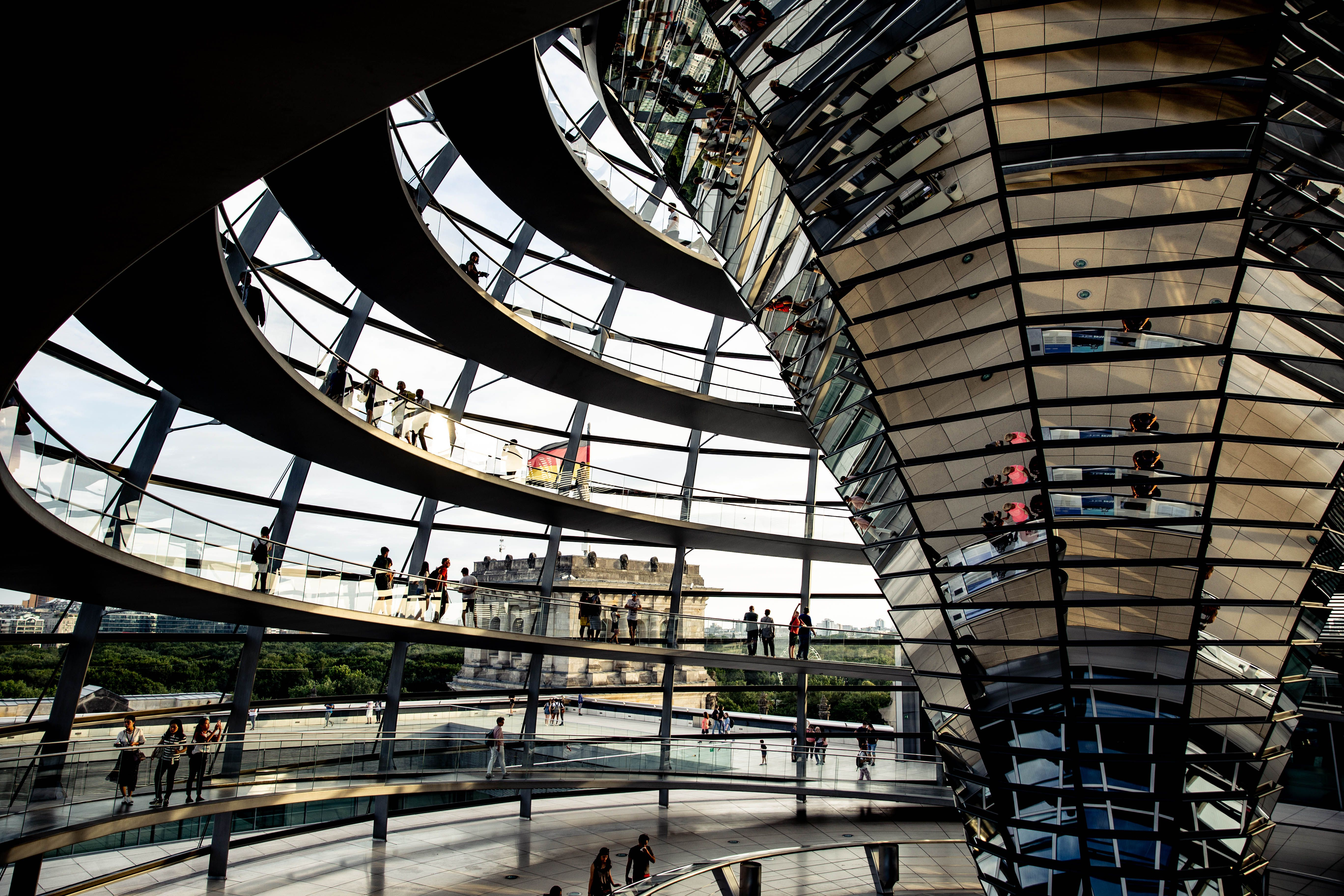 Inside the Reichstag and people walking up the winding stairs