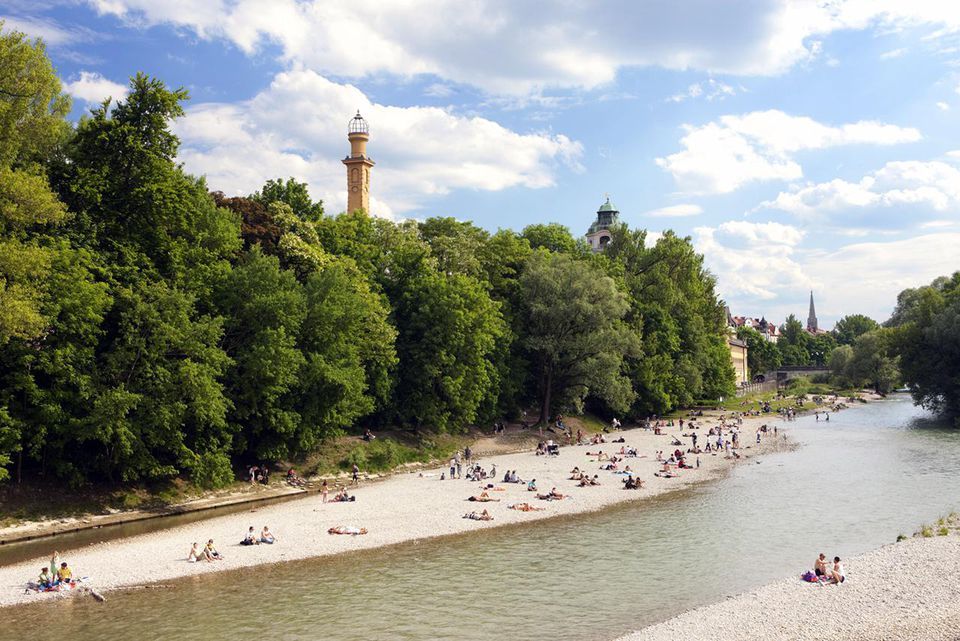 People sunbathing on the banks of the Isar, Munich, Bavaria, Germany