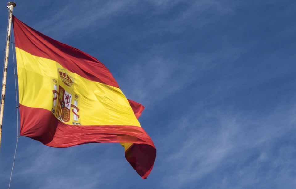 A Spanish flag flying in the breeze.