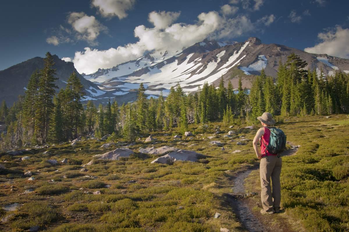 Woman hiker looking at Mt. Shasta