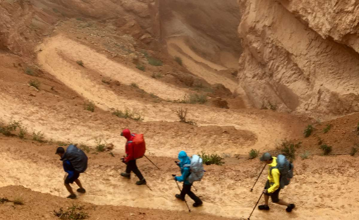 Hikers descend a narrow trail into Bryce Canyon
