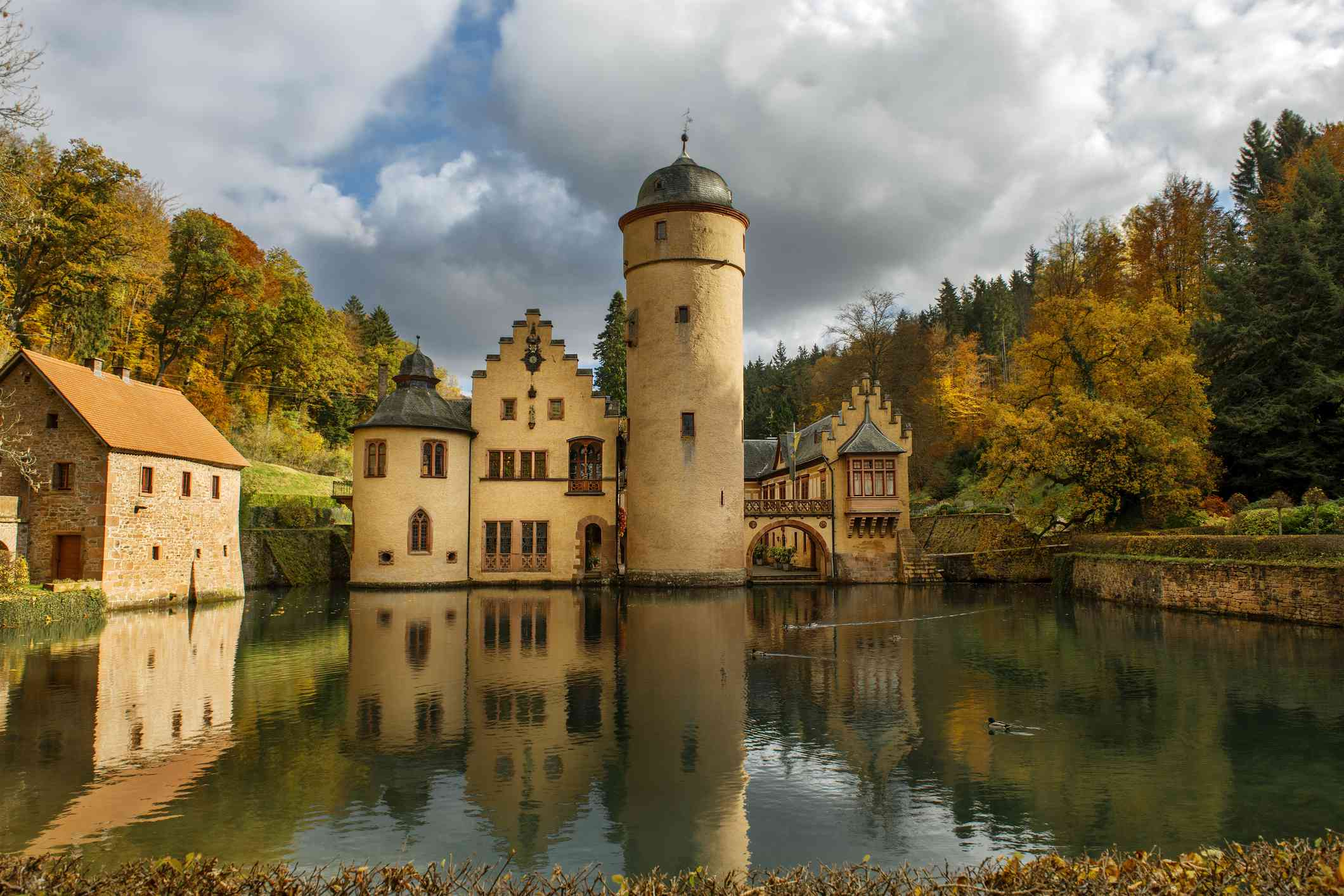 Medieval moated castle, Mespelbrunn Castle, built in the early 1400's is situated in the Elsava valley of the Spessart forest, Bavaria, Germany.