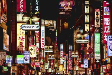 Center street in shibuya at night with dozens of illuminated signs