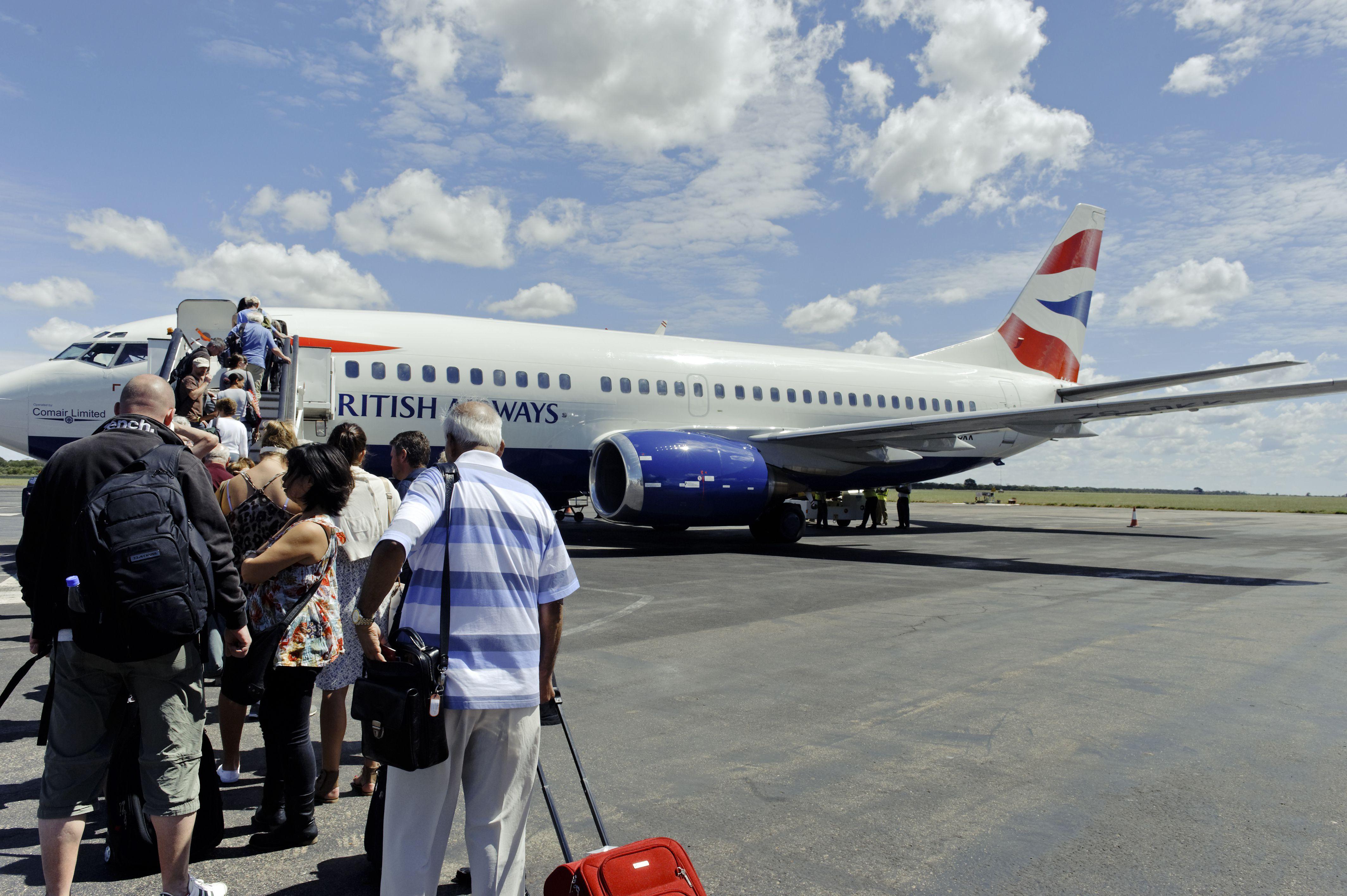Tourist boarding British Airways Boeing 737-300, Victoria Falls,Zimbabwe