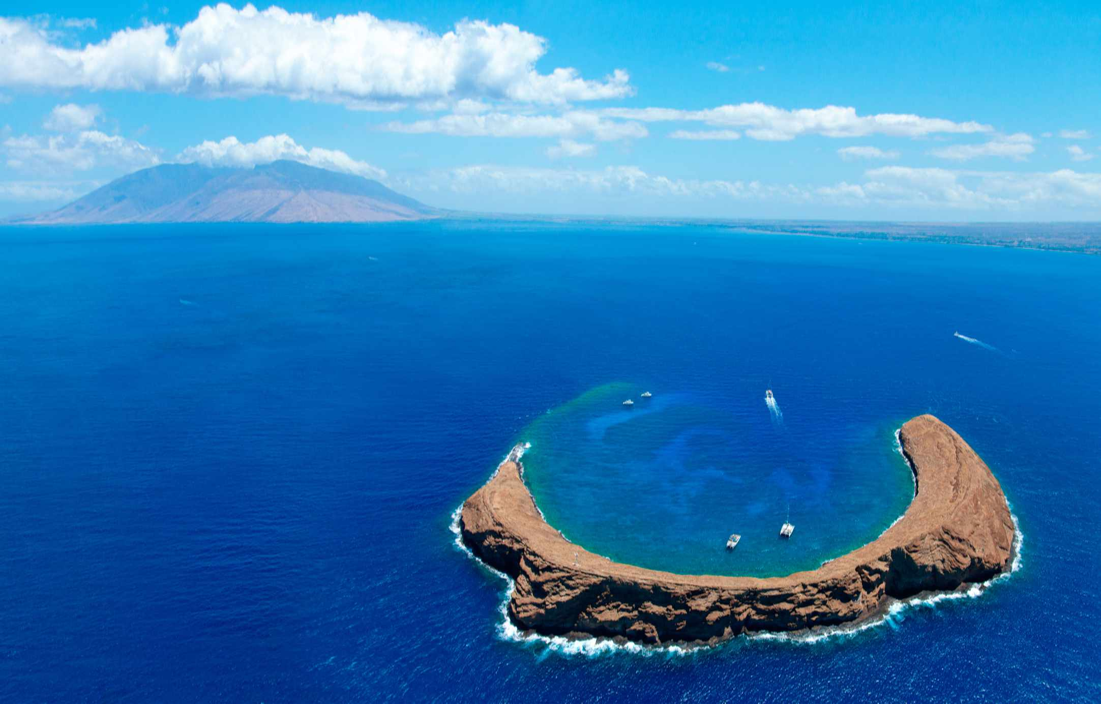View of Molokini Crater with Maui in the background