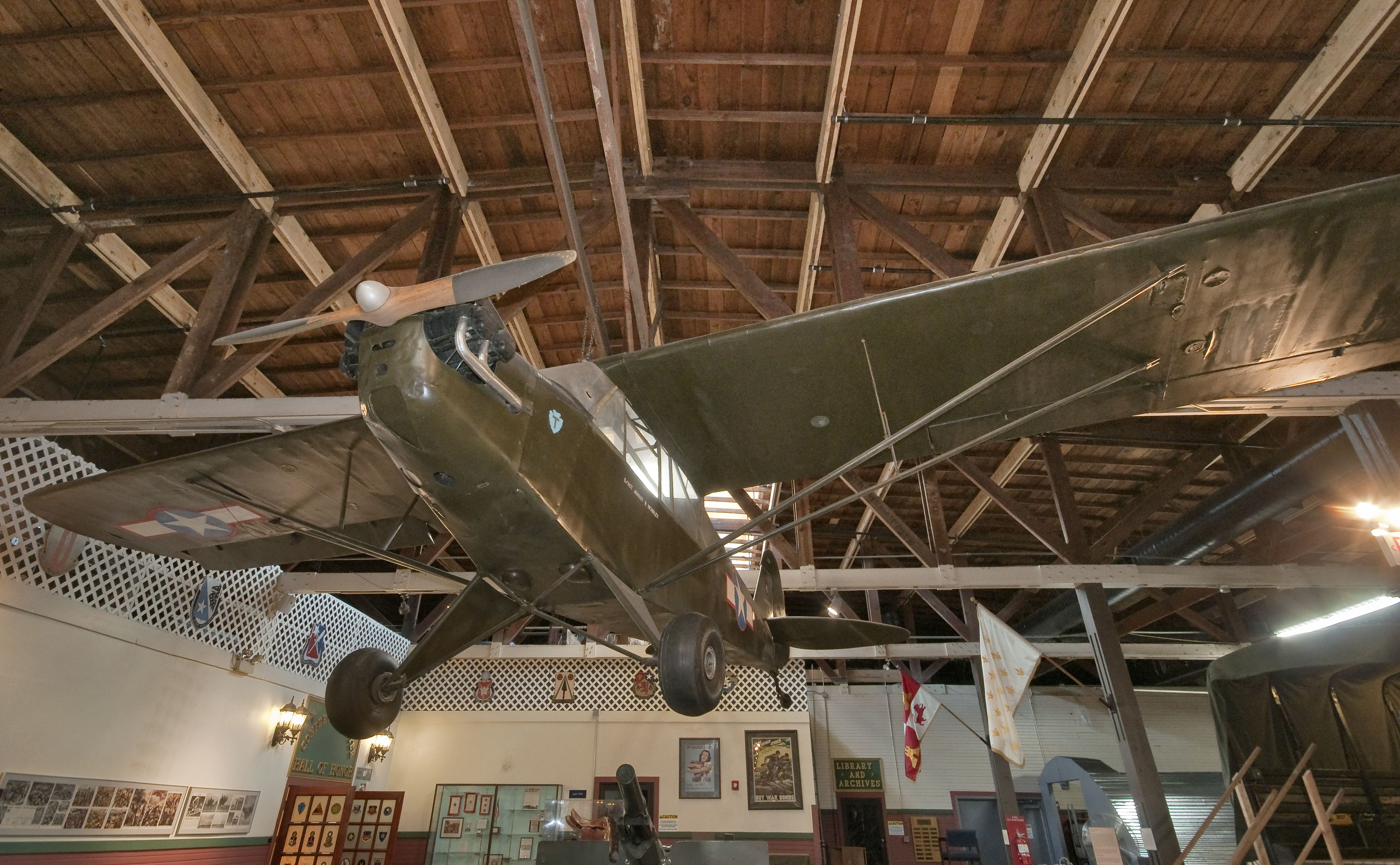 L4 Piper Cub liaison plane, Great Hall at Texas Military Forces Museum at Camp Mabry in Austin, Texas, USA