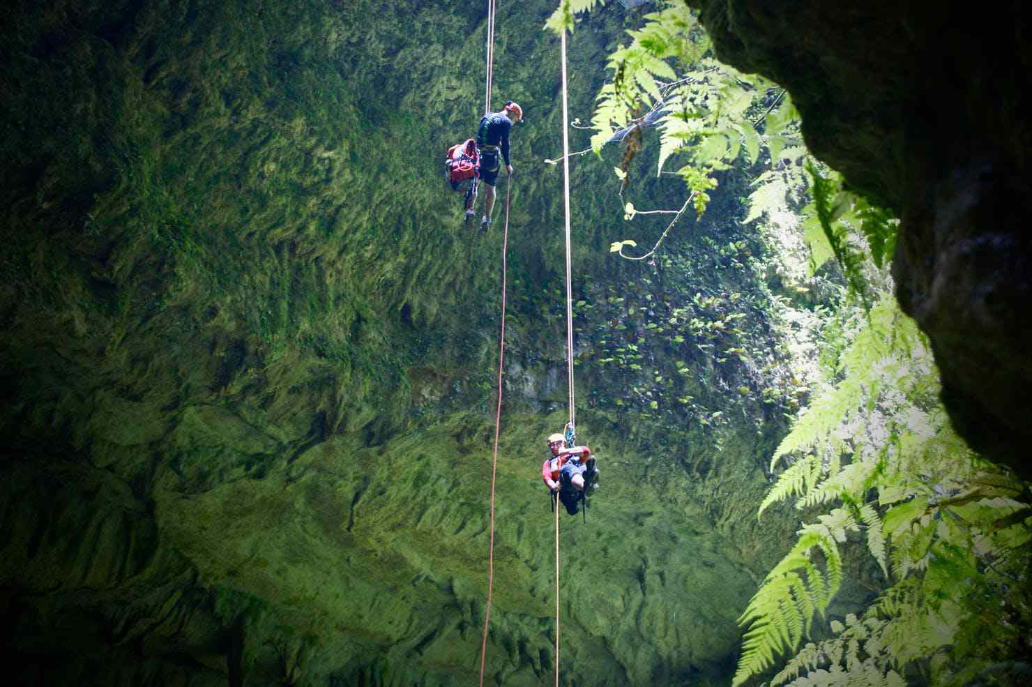 Rappelling down a mountain using Tyroleans