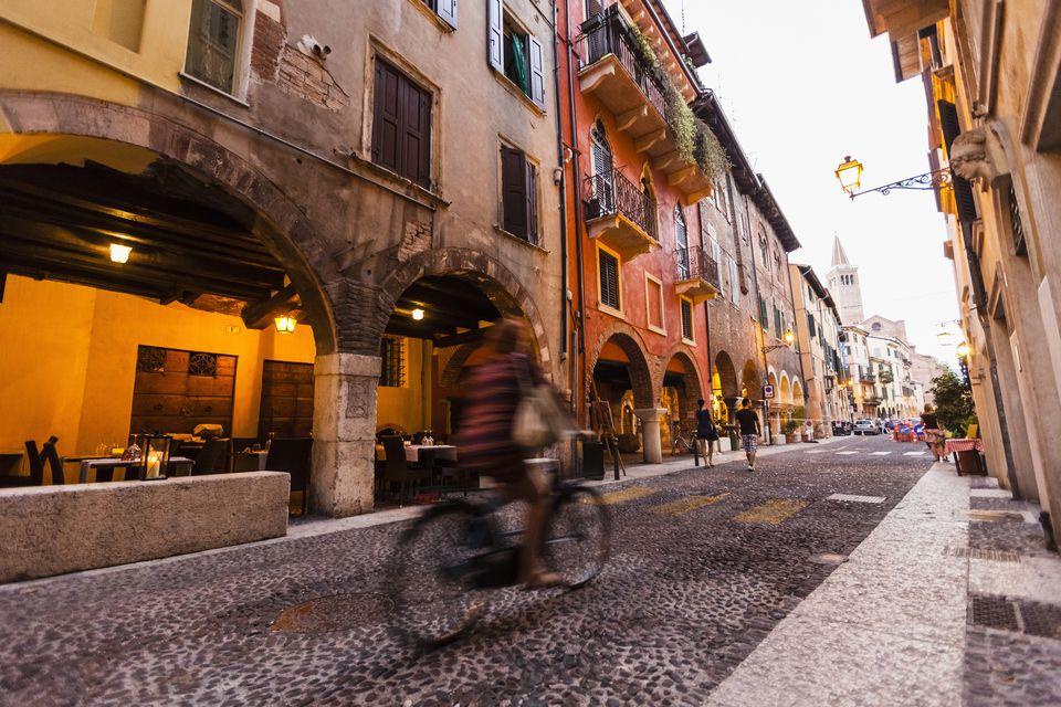 Cyclist in the historic center, Verona, Veneto, Italy