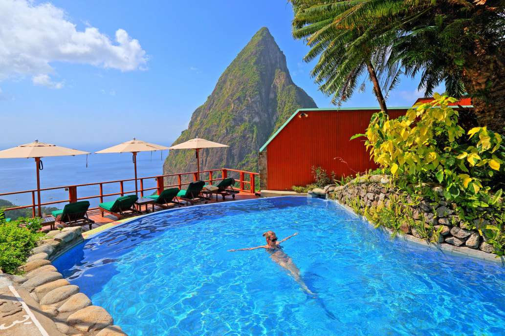 Women swimming in pool with mountain behind her Ladera Resort