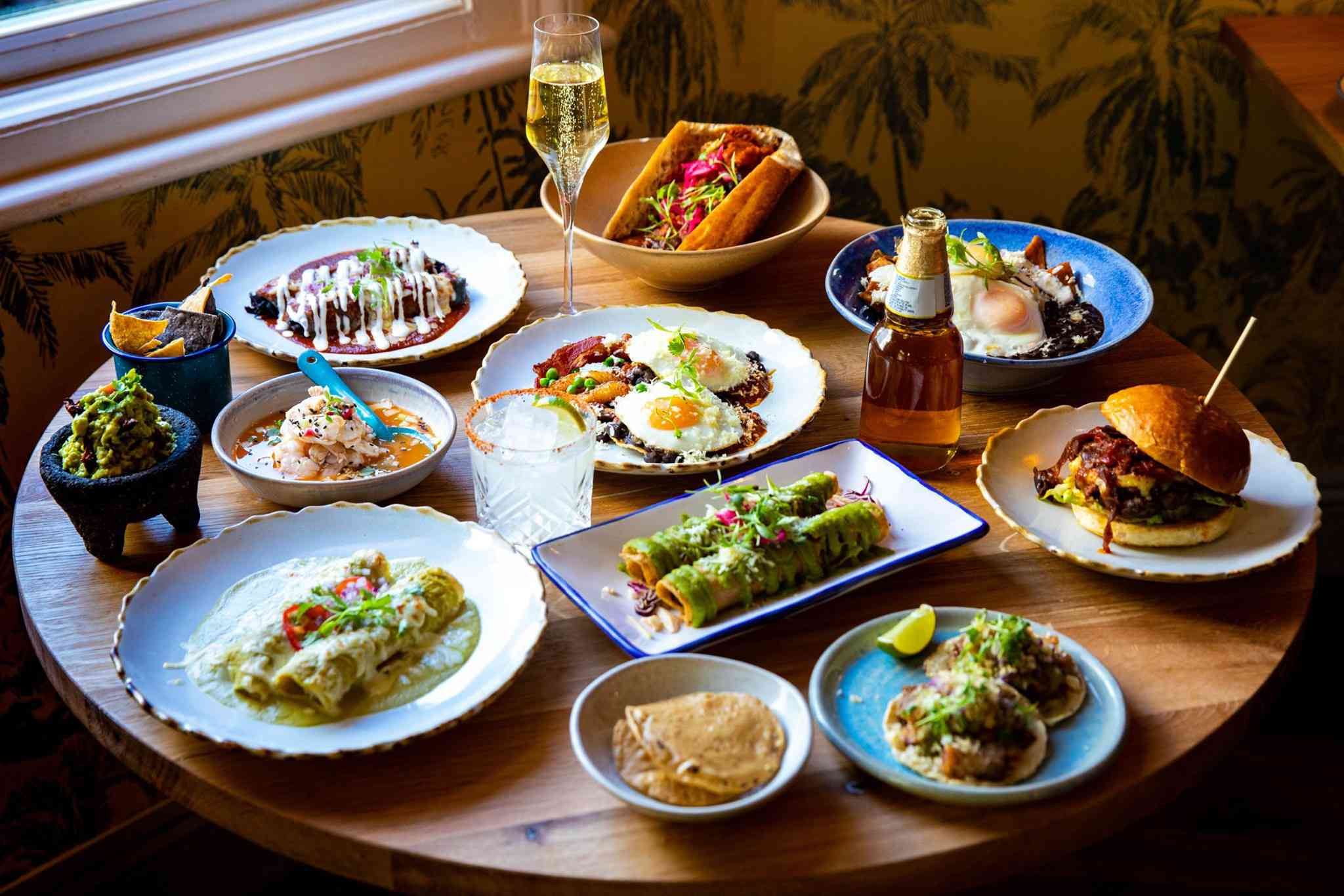 A table filled with different dishes from Santo Remedio