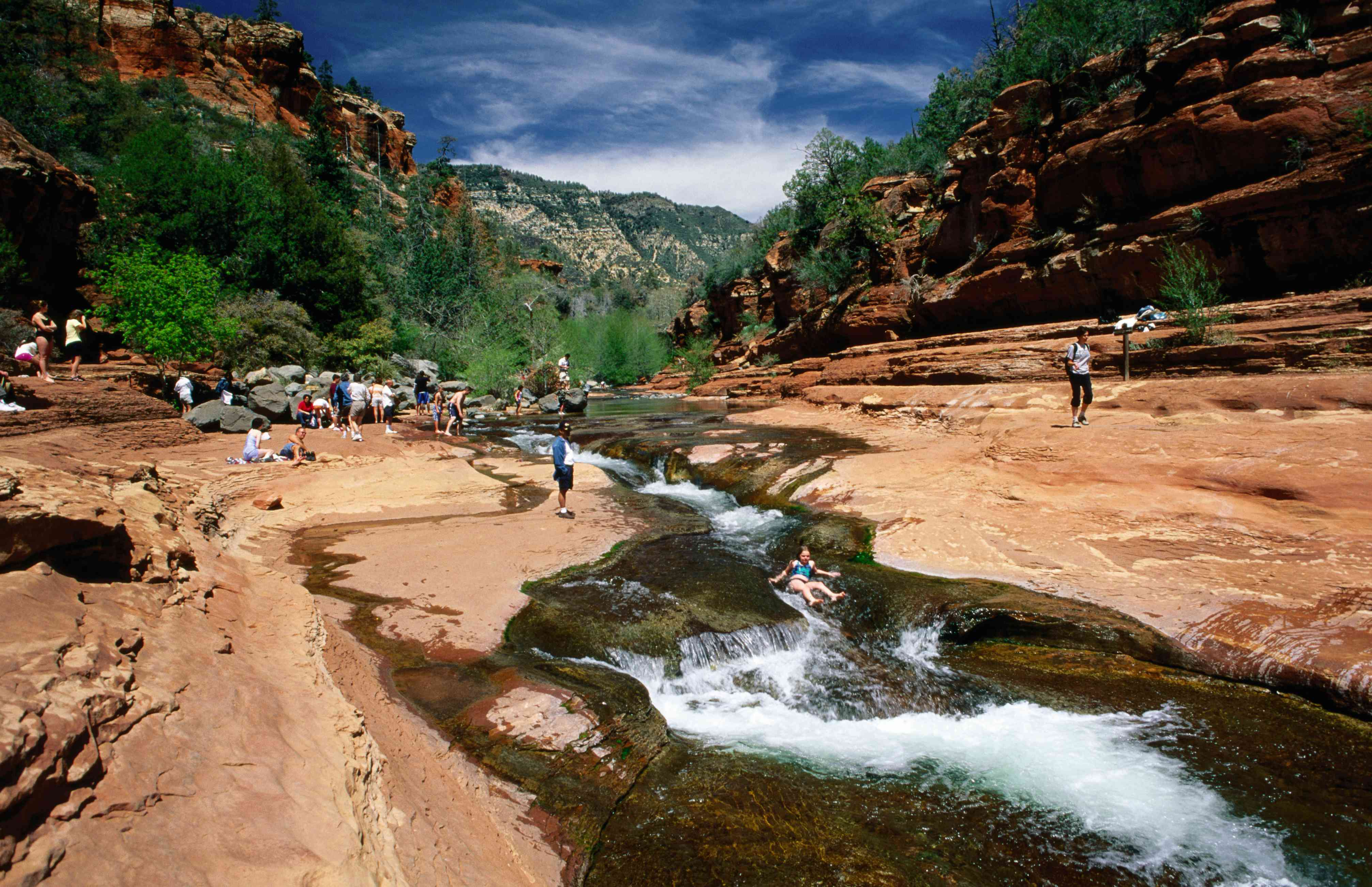 Swimmer in whitewater of Oak Creek at Slide Rock State Park.