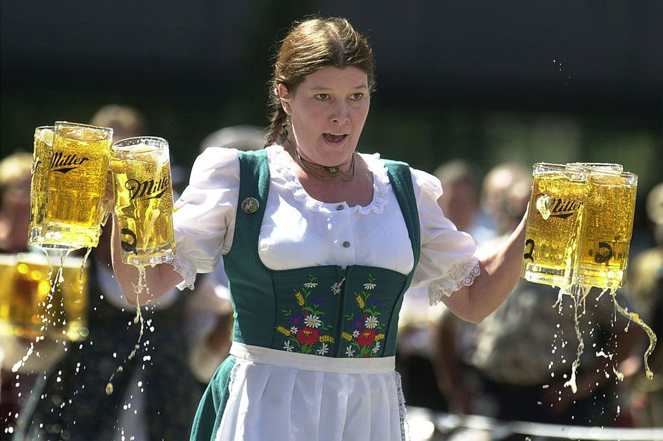Woman holding beer steins