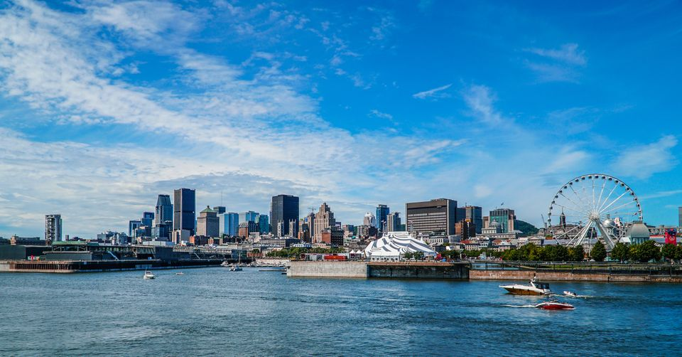 View Of Montreal At Waterfront Against Blue Sky