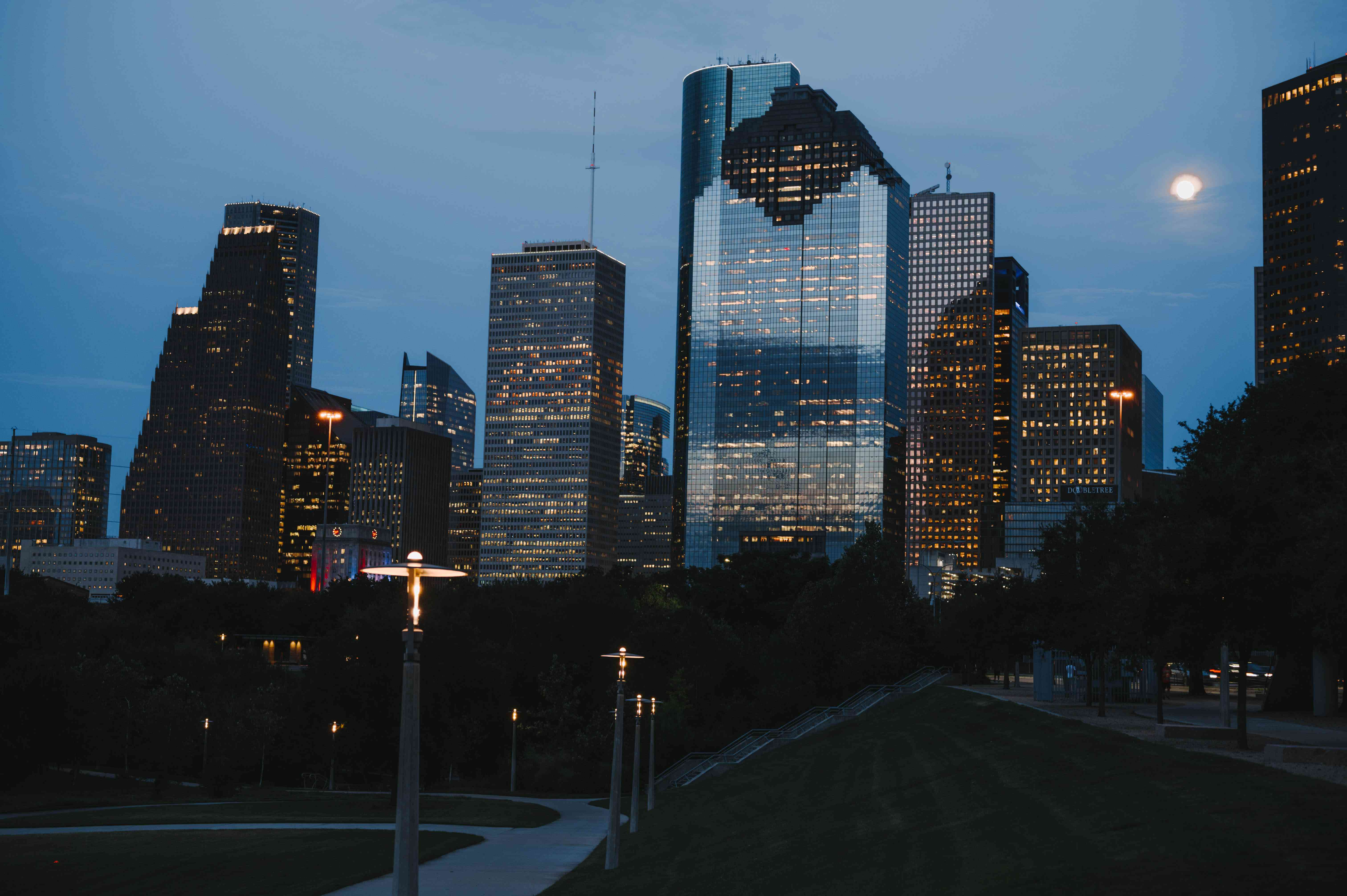 View of Houston skyline lit up at night from Buffalo Bayou Park