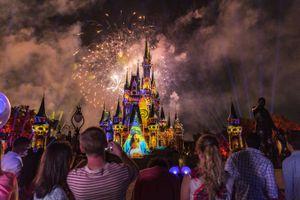 Cinderella's Castle illuminated at night at the Magic Kingdom