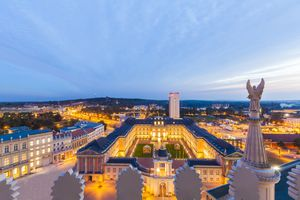 Germany, Potsdam, view to lighted Potsdam City Palace with Fortuna Portal from St. Nicholas church