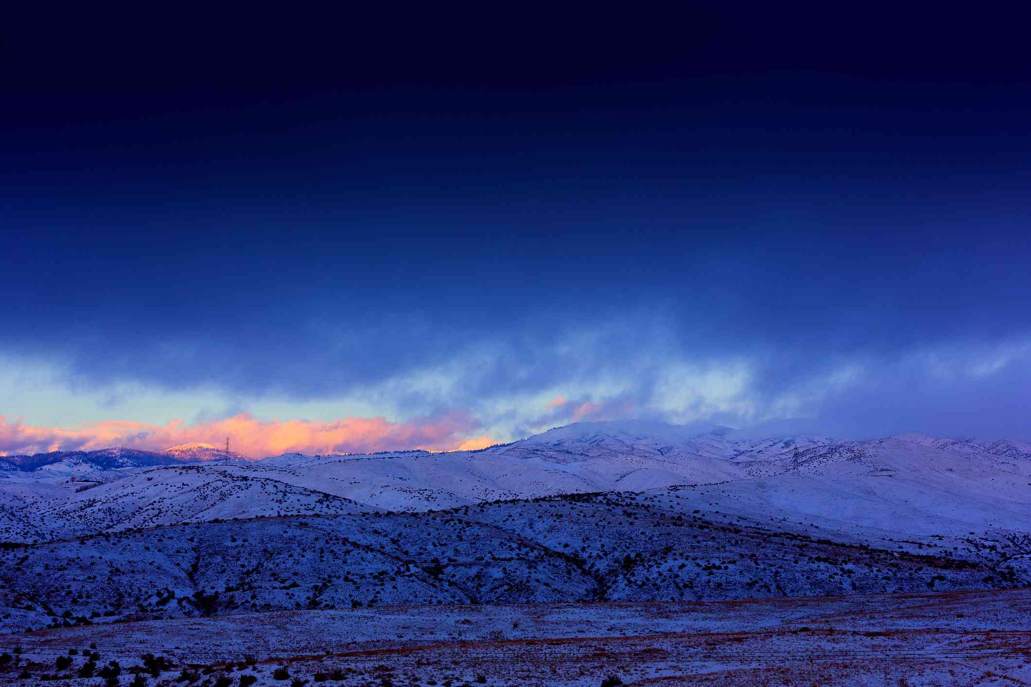 Vivid winter sunset over snowy Boise foothills and Bogus Basin ski resort, Idaho