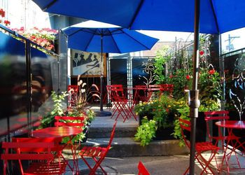 Marty's Martini Bar—open air patio of red chairs and blue umbrellas