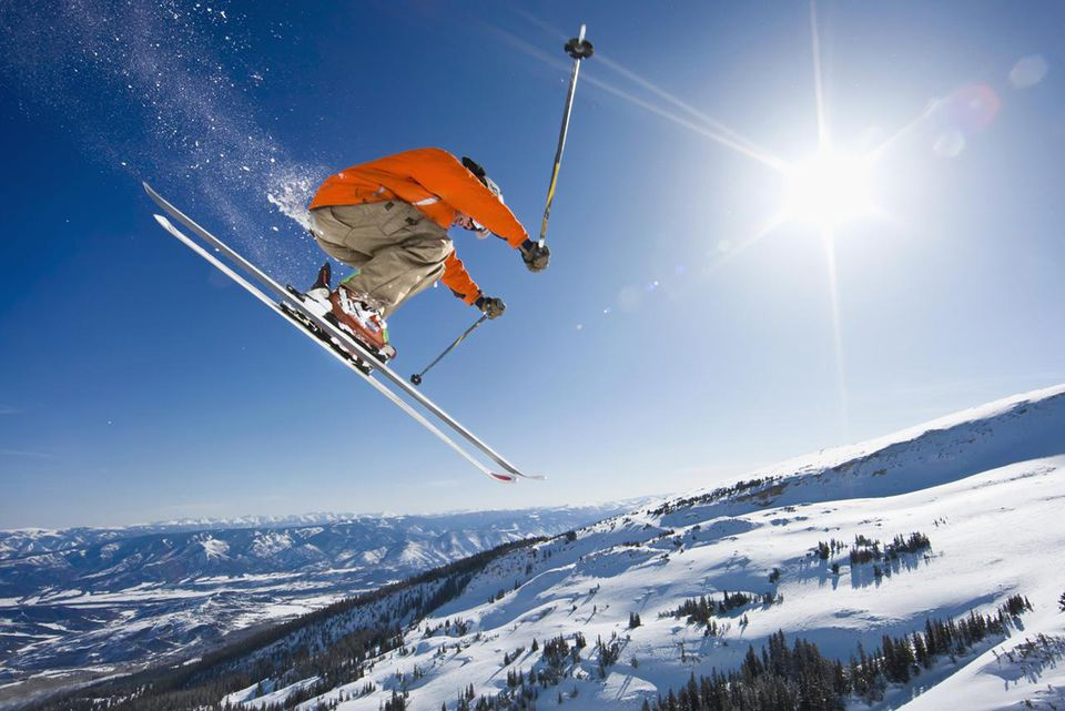 Extreme skier with sunburst.