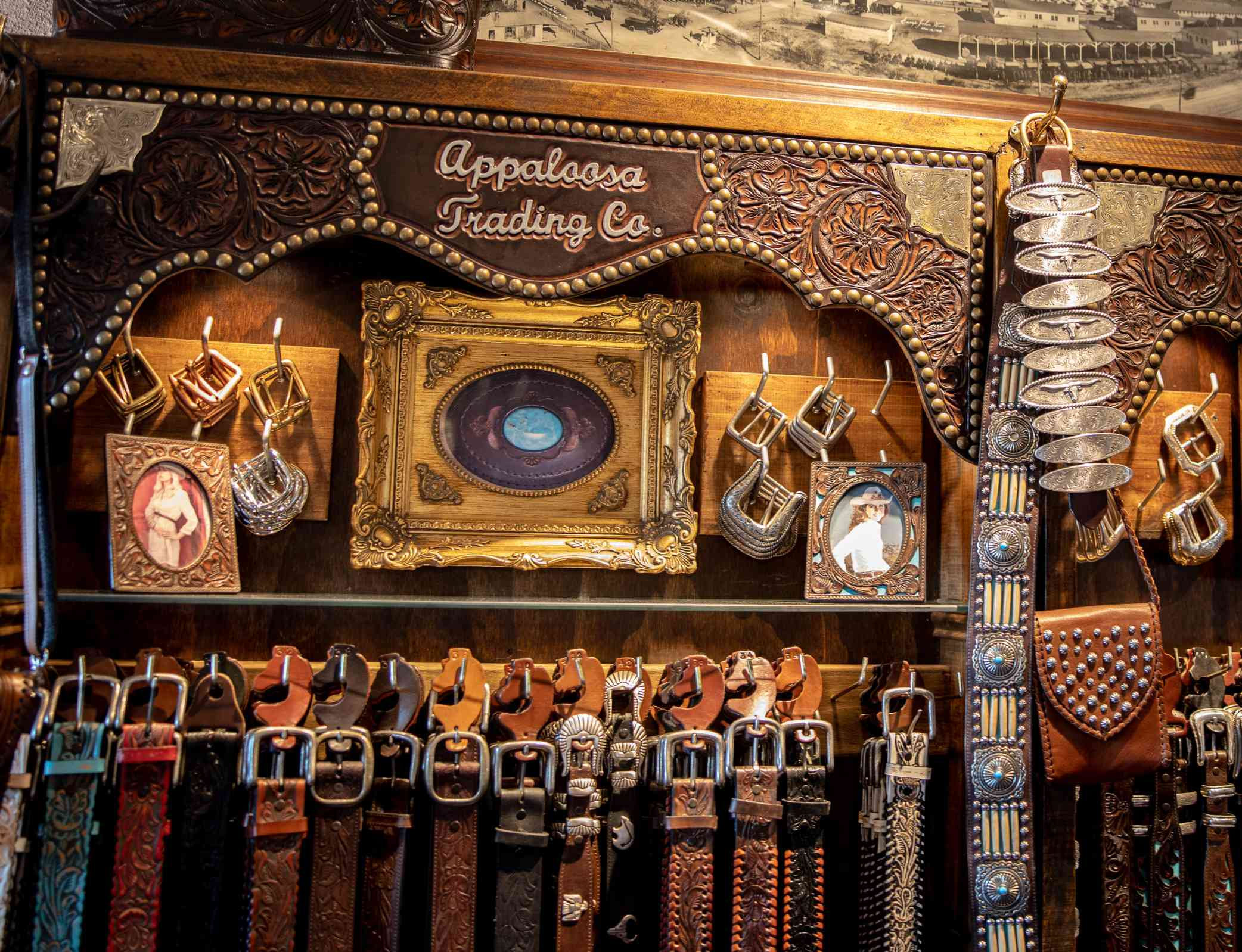 Display of intricately decorated leather belts and buckles