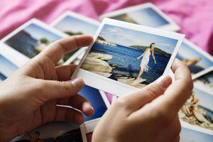 Browsing vacation photographs at home - a closeup