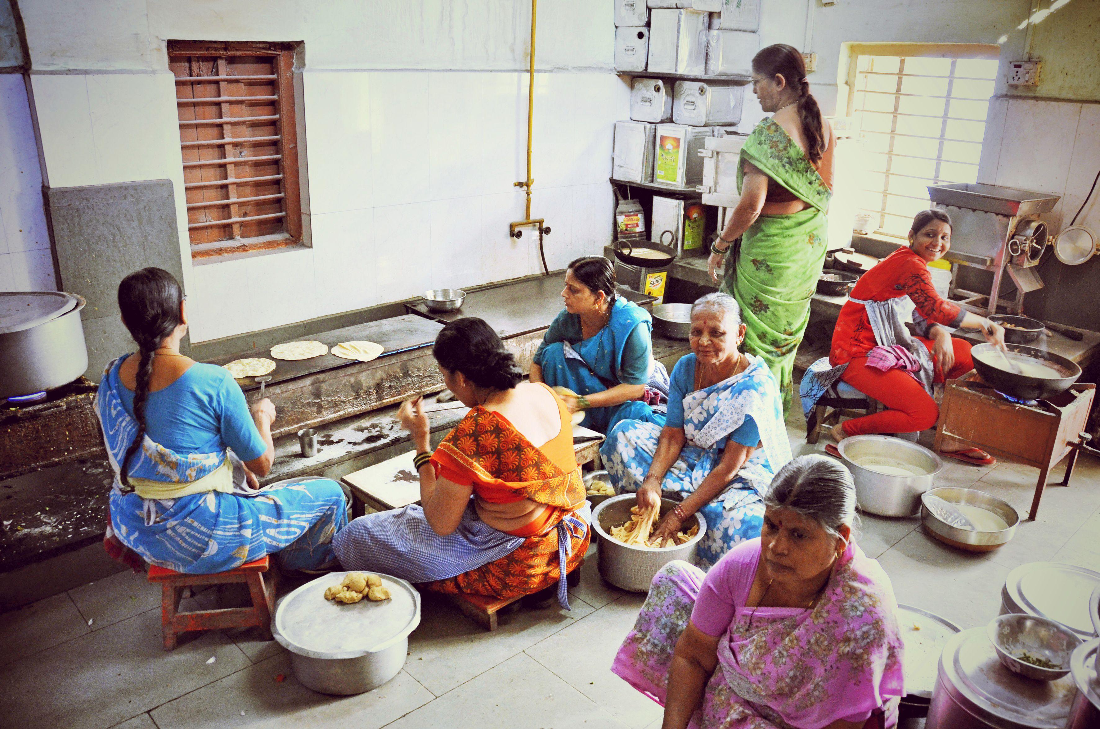 Women cooking at Mahila Mandal.