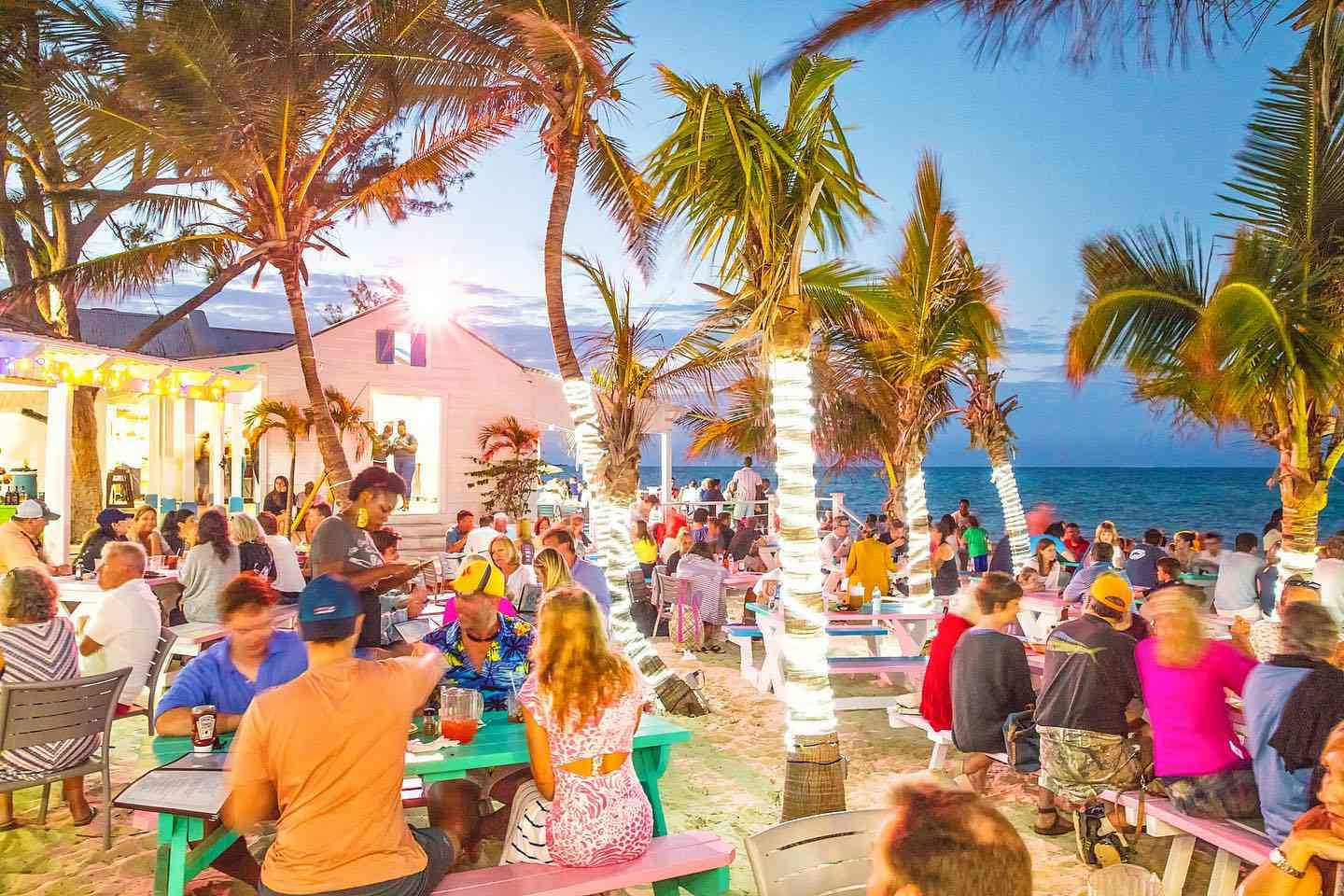 crowd of people sitting at outdoor tables at Da Conch Shack