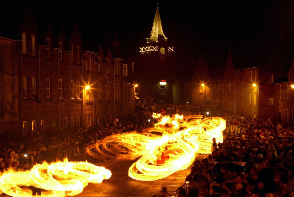 Parade of Flames under a town clock