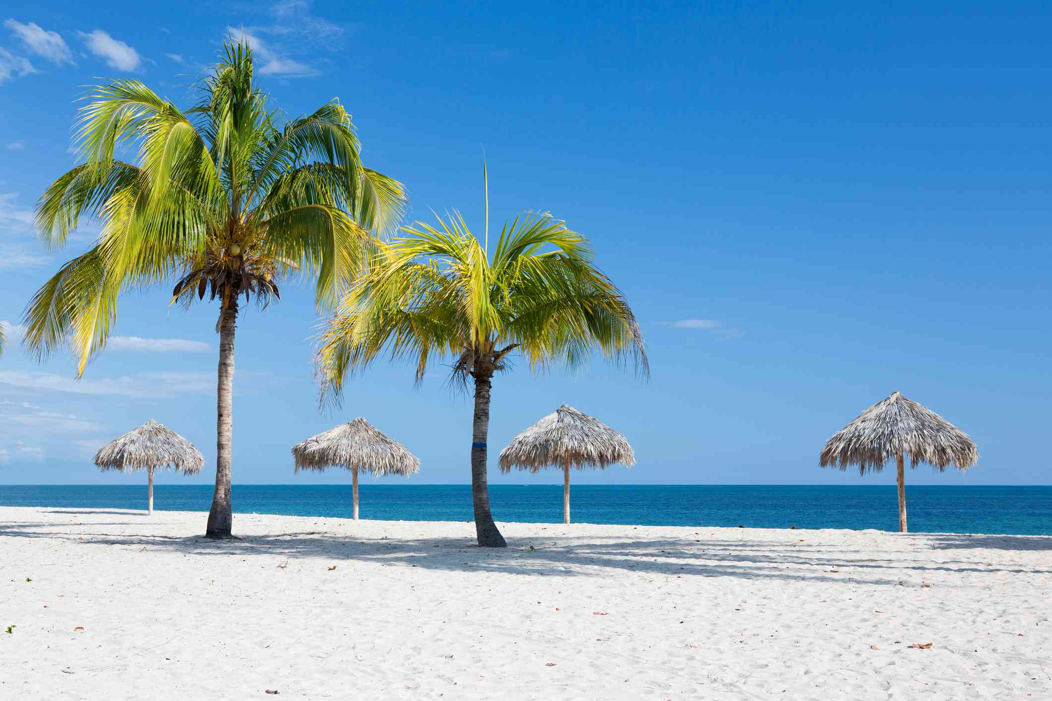 Caribbean beach with parasol in Cuba