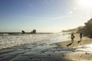 Surfers walking down the beach at El Tunco