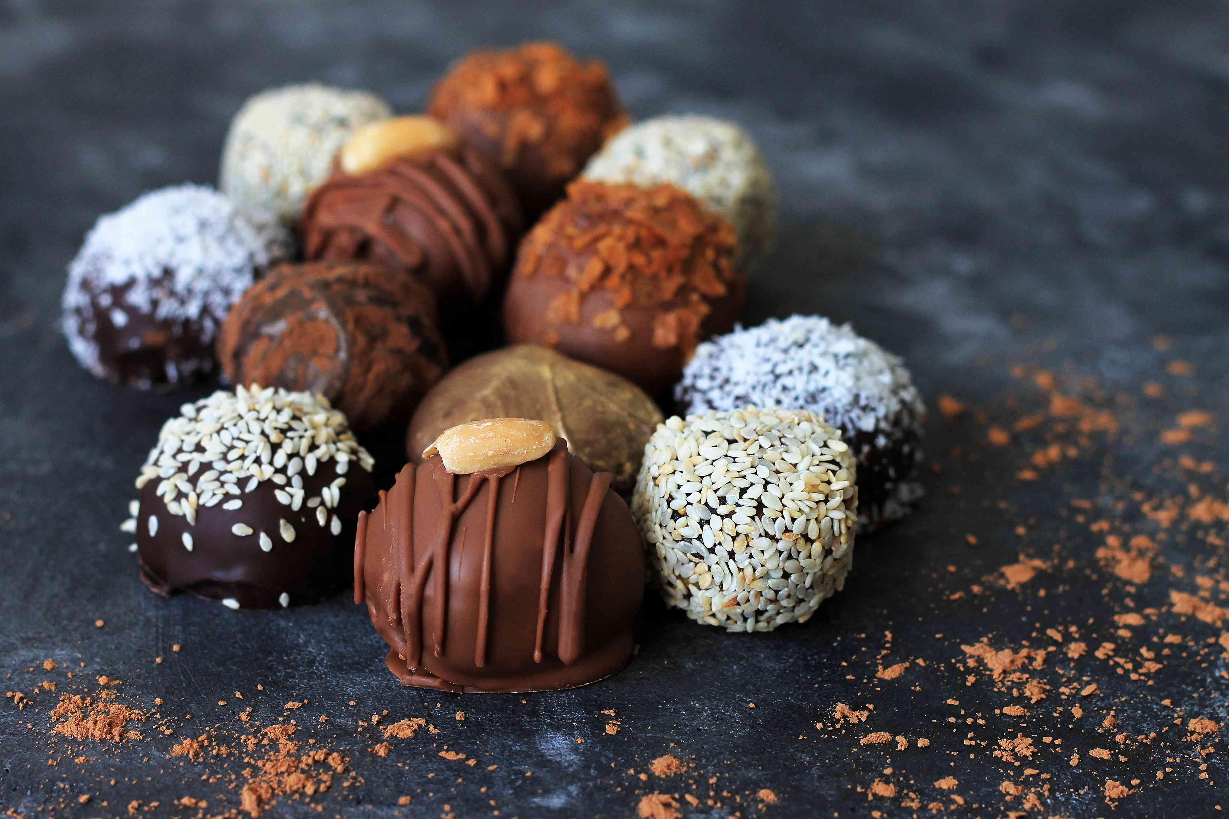 Homemade chocolate candies for Valentine's Day on dark background.