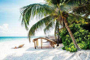 Sun loungers on beach, Tulum, Riviera Maya, Mexico