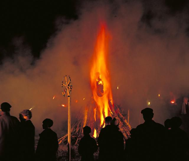An effigy of Guy Fawkes burning during festival.