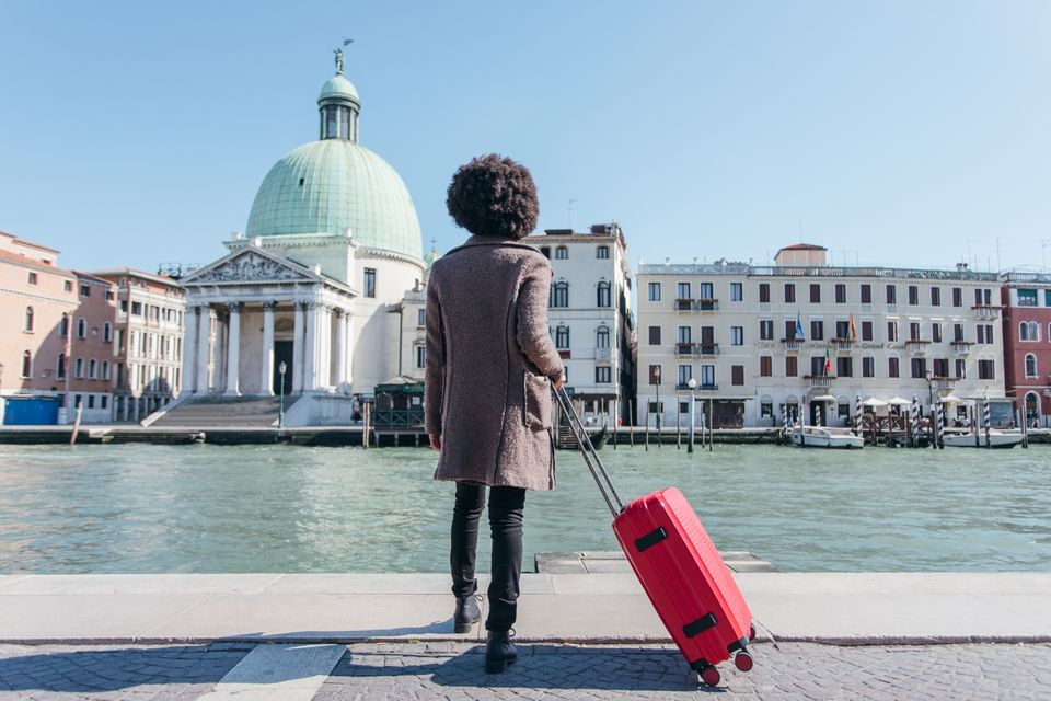 Tourist young woman arriving at Venice Santa Lucia Station