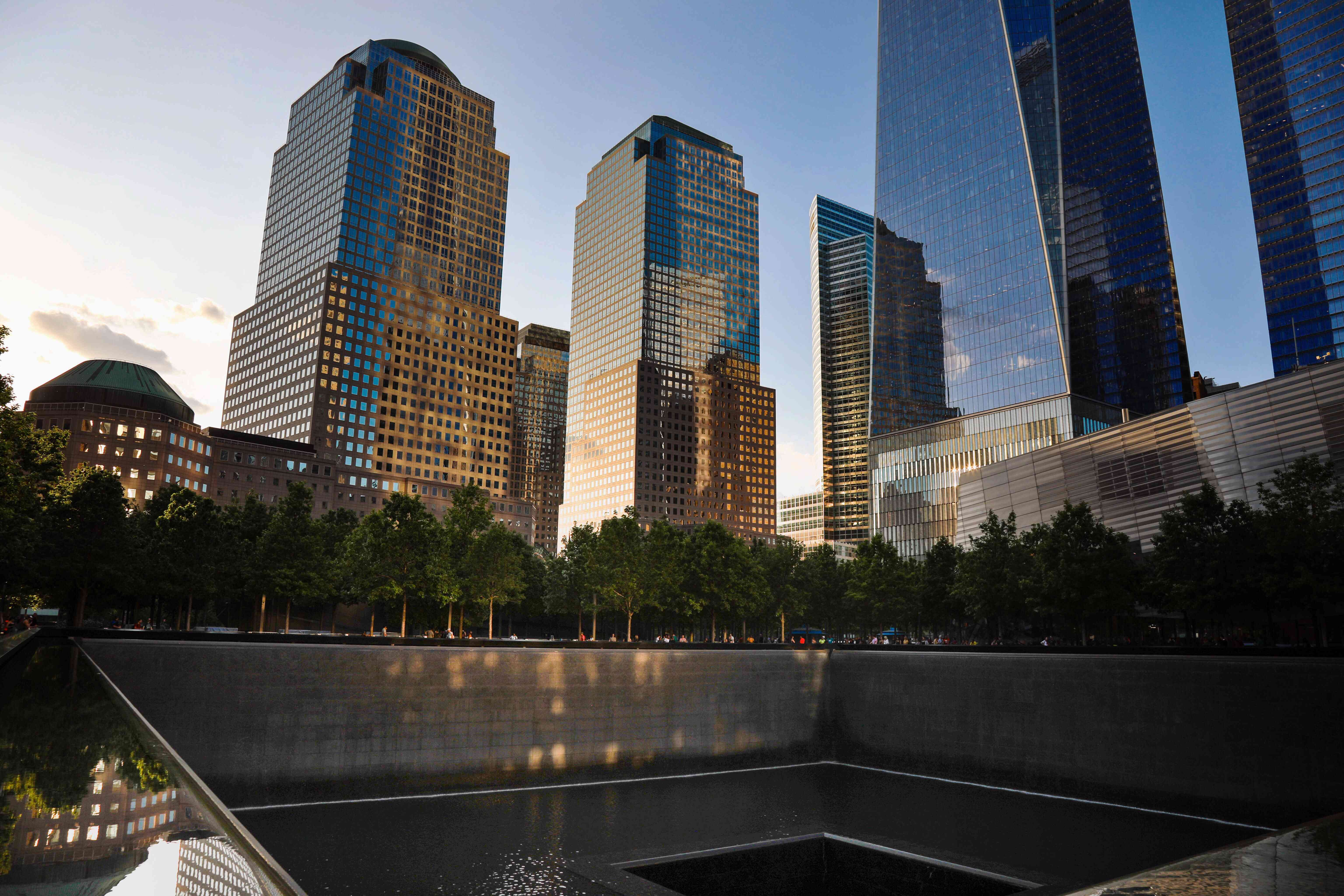 The 9-11 memorial waterfall with skyscrapers in the background