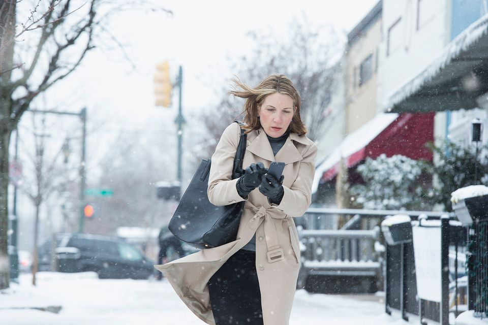 Woman on phone in the snow