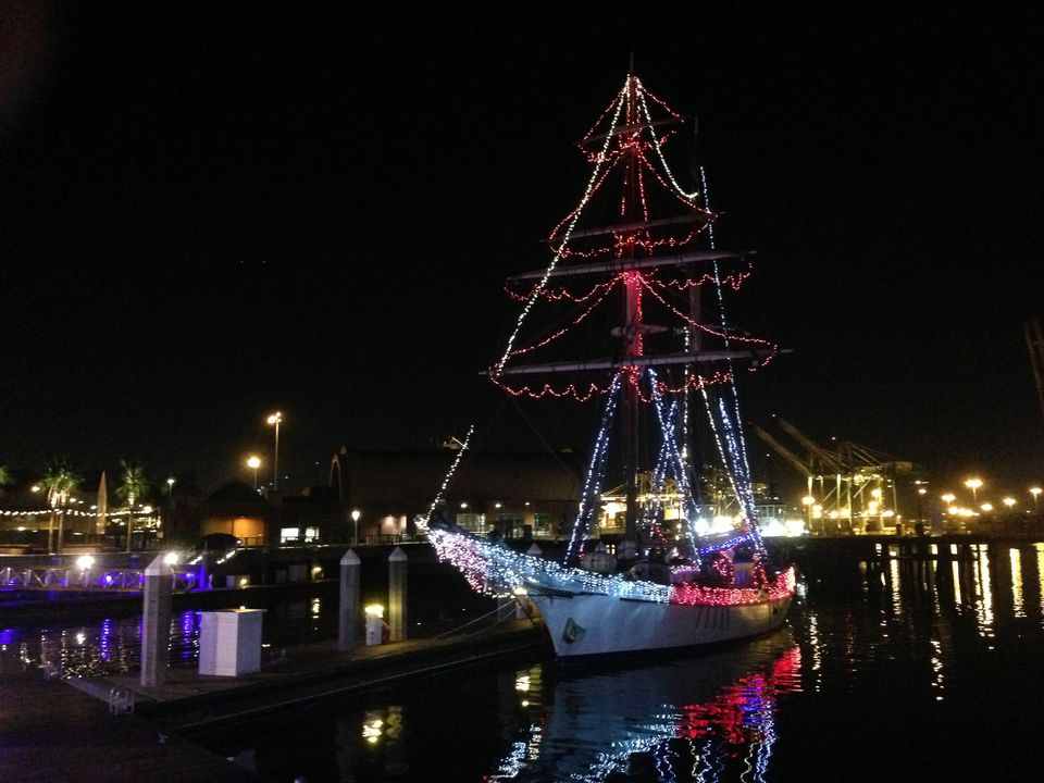 Sailboat decorated for the Christmas Boat Parade in alamitos Bay, Long Beach