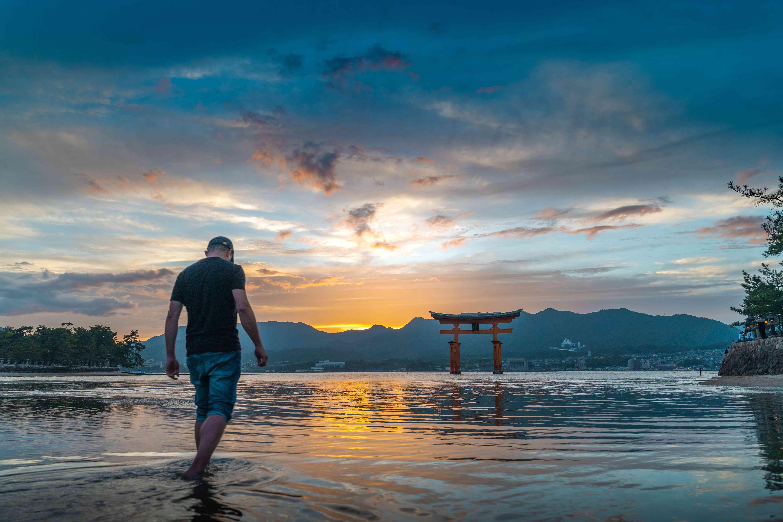 Man walking in the water in Miyajima