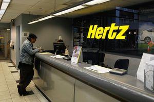 A customer talks with a Hertz car rental agent.