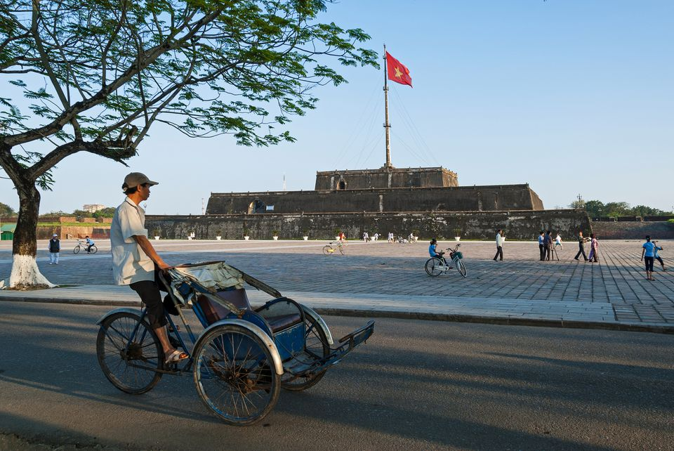 Cyclo driver in front of Hue Citadel, Vietnam