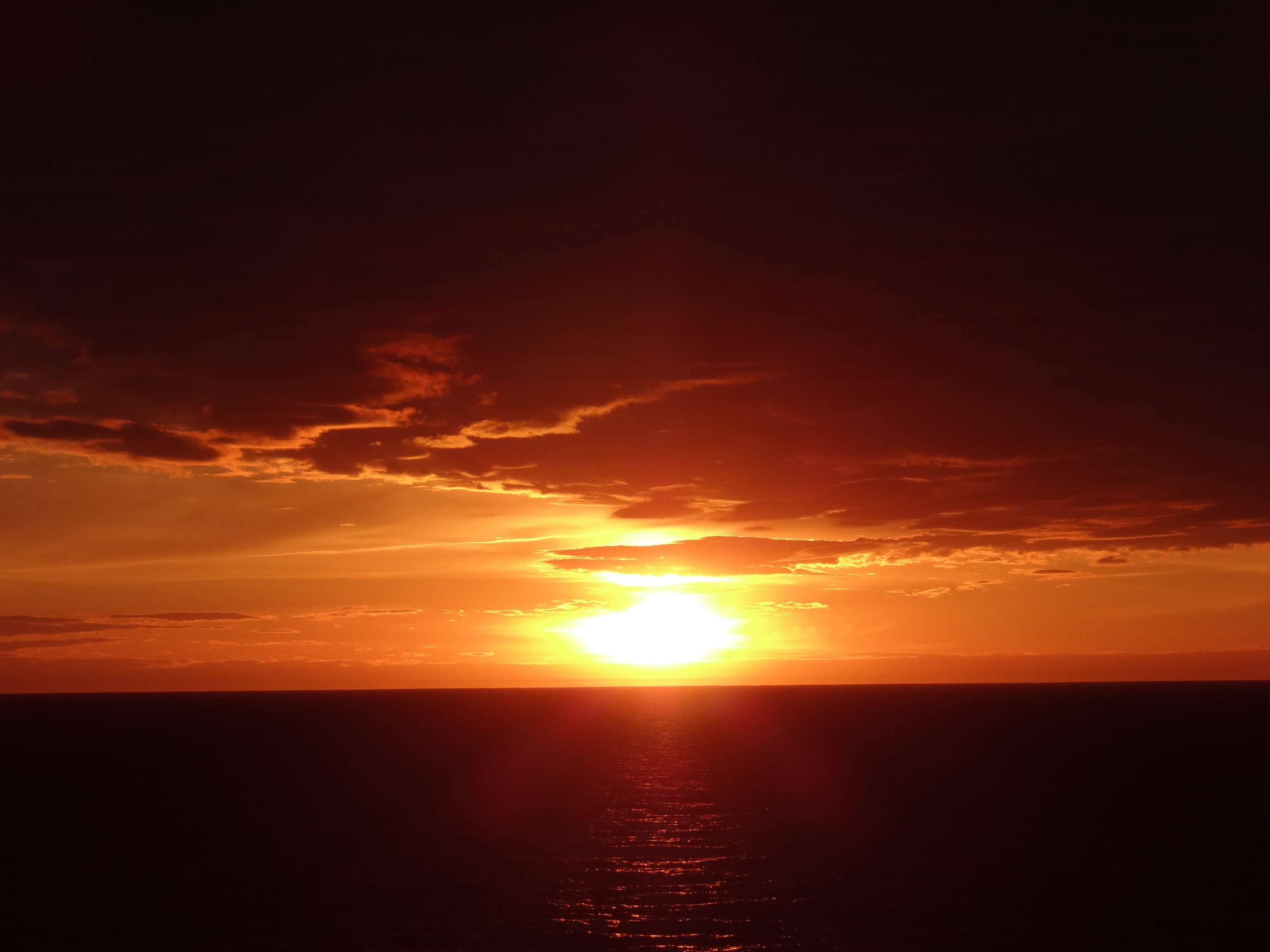 Sunset over the ocean as seen from a Princess Cruises Ship